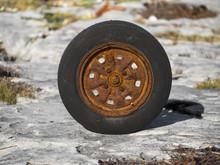 Old Worn Car Wheel With Rusty Rim.