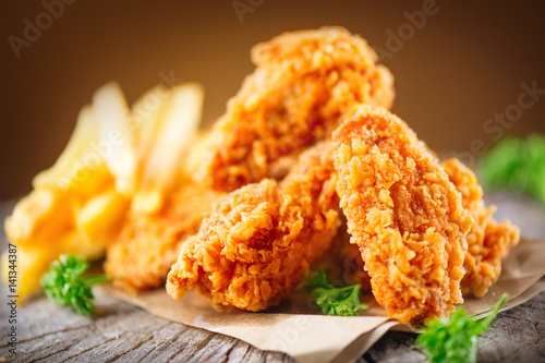 Crispy fried kentucky chicken wings on wooden table