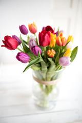 Obraz Colorful tulips in a glass vase