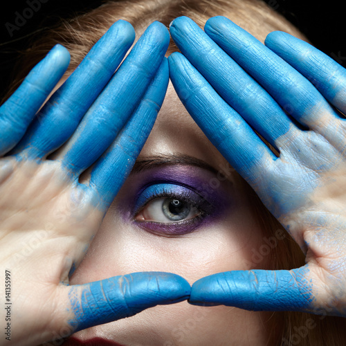 Photo  Eye of Providence, eye pyramid symbol made of hands and female face