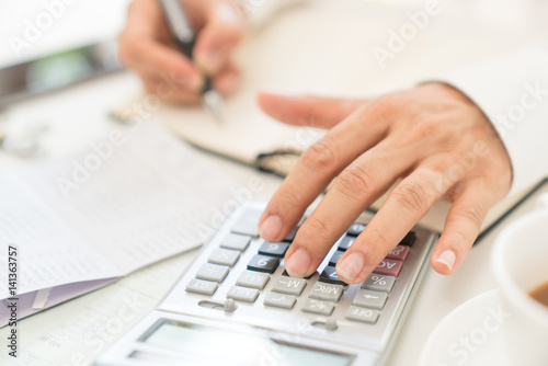 Fototapeta Close up man  doing finance at home office with calculate expenses obraz