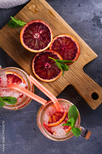 Fototapety, obrazy: Bloody orange cocktail garnished with mint in the jars. View from above, top studio shot