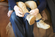 Adult Helping Child With Shoes