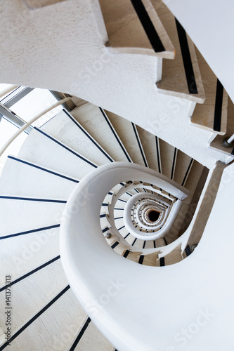 Photo Stands Stairs Photo white spiral staircase with many steps and interesting geometry