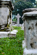 Old grey tombstones. Cemetery in Malaysia