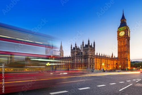London scenery at Westminster bridge with Big Ben and blurred red bus, UK Poster