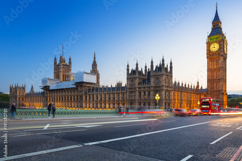 London scenery at Westminster bridge with Big Ben and blurred red bus, UK Canvas