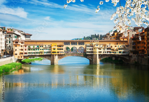 Stampa su Tela  famous bridge Ponte Vecchio over waters of river Arno, Florence at spring day, I