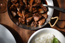 Cooked Teriyaki Meat Food In Sauce Pan With White Rice Bowl