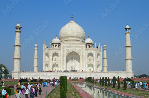 Fotografie, Obraz  Iconic perspective of the Taj Mahal mausoleum in Agra, India, with the reflection pool and the main building dome framed by the minaret towers
