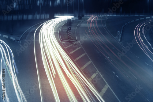 Long exposure photo of traffic with blurred traces from cars #141419396