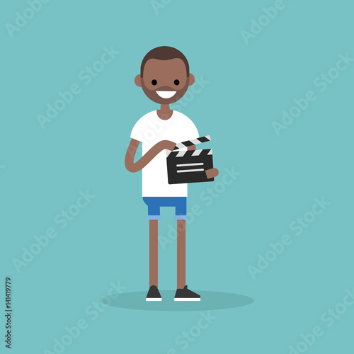 Valokuva  Camera crew: young black assistant holding a clapperboard / editable flat vector