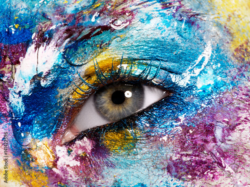 Fototapety, obrazy: Beauty, cosmetics and makeup. Magic eyes look with bright creative make-up. Macro shot of beautiful woman's face with perfect art make up. Closeup of female eye. Body art