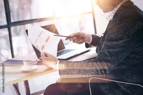 Fotografie, Obraz  Businessman working with laptop at sunny office