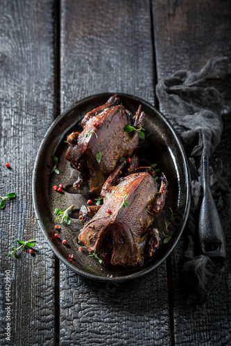 Two roasted pigeons with pepper and spices