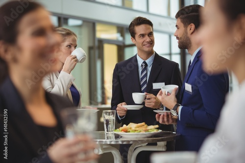 Fotografie, Obraz  Businesspeople interacting with each other while having coffee
