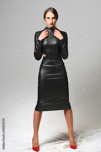Pretty Girl Wearing Sexy Black Dress And Red Shoes Buy This Stock
