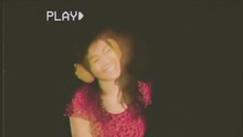 Fake VHS Tape: A Beautiful Young Woman Dancing And Listening To Music With Headphones, Looking Frantic. She's On Focus But Some Blurred Images Of Her Appear Delayed In Order To Emphasize Motion.