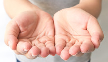 Close Up Outstretched Cupped Hands Of Young Woman Selective Focus