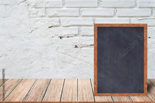 Chalkboard wood frame, blackboard sign menu on wooden table and with ...