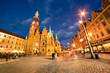 Colorful evening scene on Wroclaw Market Square with Town Hall.