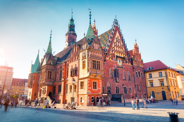 Colorful morning scene on Wroclaw Market Square with Town Hall.