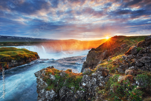 Godafoss waterfall at sunset. Fantastic landscape. Beautiful cumulus clouds. Iceland Europe