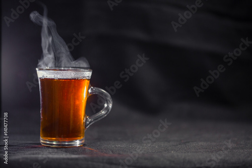 Autocollant pour porte The the Cup of tea on a dark background.