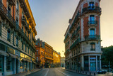 Fototapeta Uliczki - Narrow historic street with old buildings in Toulouse, France