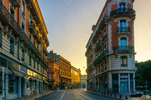 Narrow historic street with old buildings in Toulouse, France