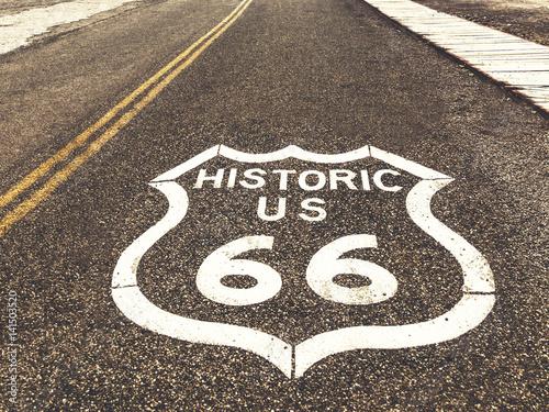Fotografia, Obraz  Historic US Route 66 highway sign on asphalt in Oatman, Arizona, United States