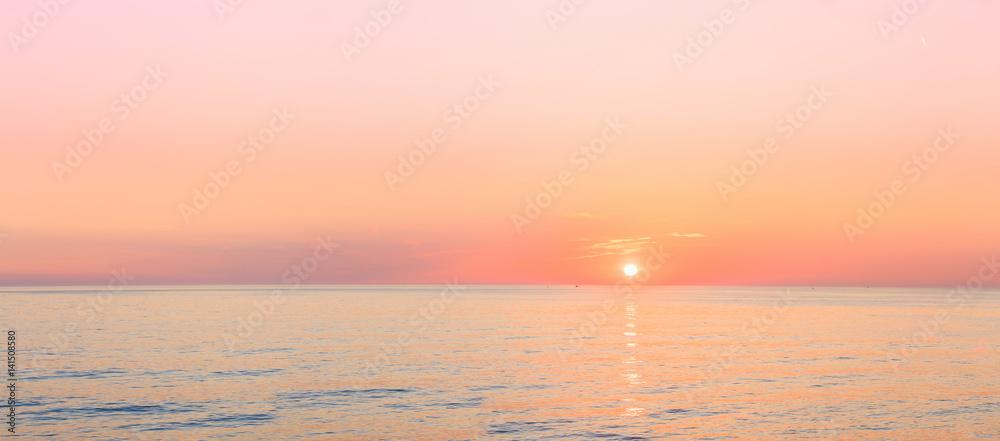 Sun Is Setting On Horizon At Sunset Sunrise Over Sea Or Ocean.