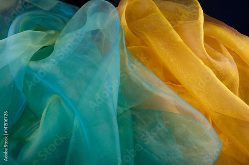 Fotografie, Obraz  Decorative background made of green and yellow transparent silky cloth