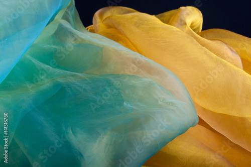 Fototapeta  Combination of green and yellow transparent organza fabric