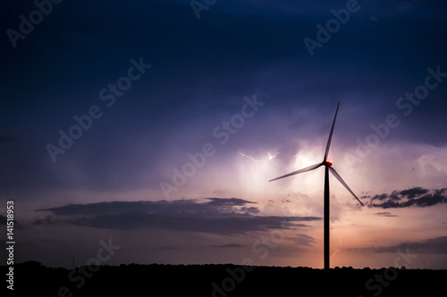 Lightning storm near wind turbines Poster
