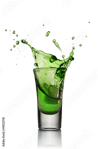 Fotografie, Obraz  Glass of alcoholic drink with ice. Absinthe or mint liquor shot