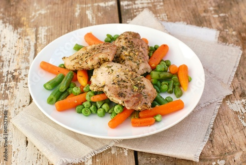 Food from pork meat fillet with spices and spring vegetable