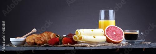 Fototapeta breakfast on table with waffles, croissants, coffe and juice obraz