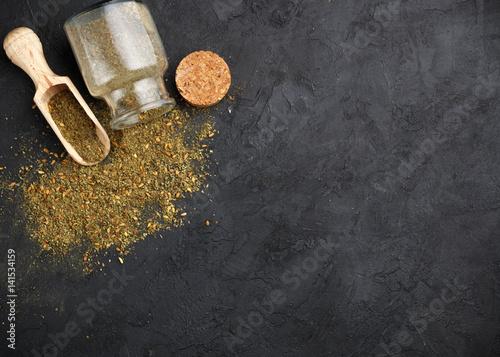 Photo  Zaatar - mix of Oriental spices on a dark stone background