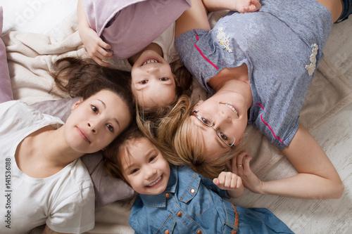Fototapeta Happy loving family.  Mother with little daughters  having fun in children room. obraz na płótnie