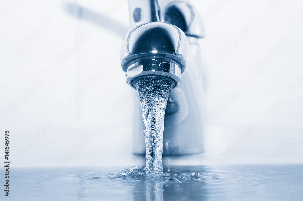 Fototapeta Faucet with flowing water closeup
