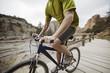 Mid-section of mountain biker on footbridge