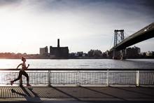Female Runner On Promenade