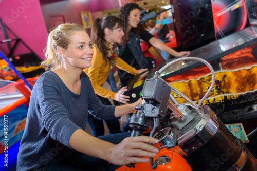 Photo Woman on arcade motorcycle
