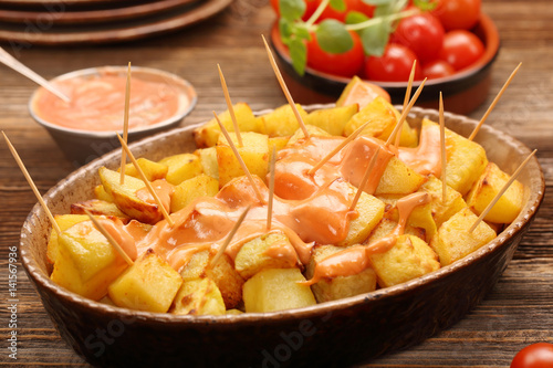 Fotografiet Patatas bravas traditional Spanish potatoes snack tapas