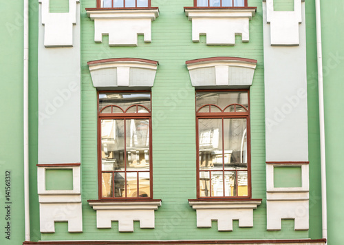 Foto op Aluminium Op straat Vintage building and windows with brick wall background