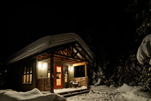 Small Cabin At Night During Wi...