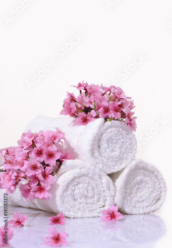 Foto op Aluminium Spa Tropical Spa with blooming branch with towel