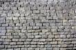gray bricks wall texture, location - Wellington, New Zealand statue near the Parlament building