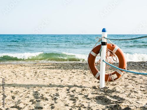 Valokuva  Lifebuoy on a sandy sea beach in Terracina, Italy